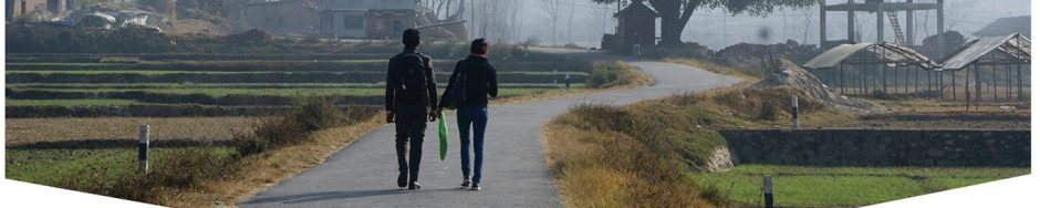 Young people walking along a path towards their future